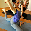 Ashley Quinn, left, stretches into Pigeon Pose as Andrea Flanagan watches during a Spontaneous Yoga class held in Quinn's apartment in Boulder on Tuesday, September 4, 2012. Jessica Cuneo/ For the Daily Camera.