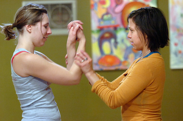 "Instructor Angela Gerardi, at right, helps Tessa Kaczor with a wrist exercise during the Tao Power class at the Soul Tree Studio in Lafayette on Tuesday November 30, , 2010. For more photos and a video of the class go to  <a href=""http://www.dailycamera.com"">http://www.dailycamera.com</a>.<br /> Photo by Paul Aiken / The Camera"