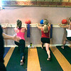 "TURBOBAR62.JPG Instructor Peter Seamans calls the count during the Turbobar class in the in the Iron Yogi studio in Boulder on Friday August 21, 2009. From left to right Kelly Gray, Randi Curtis and Kem Minnick work on the bar.<br /> Watch a video of the Turbobar class at  <a href=""http://www.dailycamera.com"">http://www.dailycamera.com</a>.<br /> Photo by Paul Aiken / The Camera"