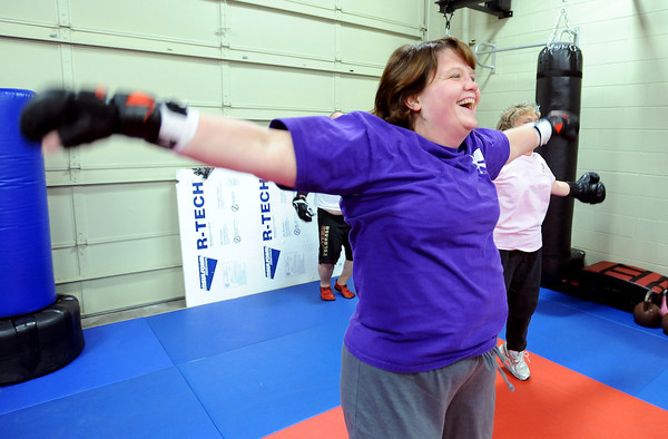 "Warrior Fit Workout of the Week55.JPG Debbie Trout laughs with her classmates during the Saturday morning workout.<br /> Michelle Jensen, of Scornavacco Martial Arts Academy in Longmont, takes us through the warrior fit workout.<br /> For a video of the workout, go to  <a href=""http://www.dailycamera.com"">http://www.dailycamera.com</a>.<br /> January 28, 2012 / Cliff Grassmick"