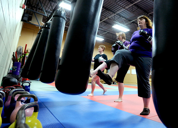 "Warrior Fit Workout of the Week24.JPG Debbie Trout, right, works the heavy bag with the rest of the class.<br /> Michelle Jensen, of Scornavacco Martial Arts Academy in Longmont, takes us through the warrior fit workout.<br /> For a video of the workout, go to  <a href=""http://www.dailycamera.com"">http://www.dailycamera.com</a>.<br /> January 28, 2012 / Cliff Grassmick"