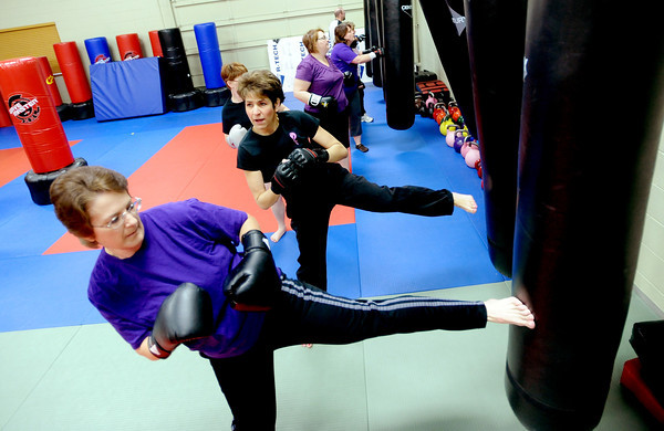 """Warrior Fit Workout of the Week40.JPG Jennifer Strand, left, kicks with the rest of the class on Saturday.<br /> Michelle Jensen, center, of Scornavacco Martial Arts Academy in Longmont, takes us through the warrior fit workout.<br /> For a video of the workout, go to  <a href=""""http://www.dailycamera.com"""">http://www.dailycamera.com</a>.<br /> January 28, 2012 / Cliff Grassmick"""