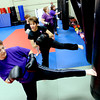 "Warrior Fit Workout of the Week40.JPG Jennifer Strand, left, kicks with the rest of the class on Saturday.<br /> Michelle Jensen, center, of Scornavacco Martial Arts Academy in Longmont, takes us through the warrior fit workout.<br /> For a video of the workout, go to  <a href=""http://www.dailycamera.com"">http://www.dailycamera.com</a>.<br /> January 28, 2012 / Cliff Grassmick"