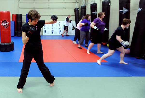 "Warrior Fit Workout of the Week38.JPG Michelle Jensen, left,  instructs the class on the punch combination.<br /> Michelle Jensen, of Scornavacco Martial Arts Academy in Longmont, takes us through the warrior fit workout.<br /> For a video of the workout, go to  <a href=""http://www.dailycamera.com"">http://www.dailycamera.com</a>.<br /> January 28, 2012 / Cliff Grassmick"