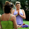"Olivia Katz, follows the instruction of teacher, Jeanie Manchester, left, during their yoga class.<br /> ""Yoga Rocks the Park"" began in Boulder's Central Park on Sunday. The yoga and music gathering will continue every Sunday through September 19, 2010.<br /> For more photos and a video of yoga in the park, go to  <a href=""http://www.dailycamera.com"">http://www.dailycamera.com</a>.<br /> Cliff Grassmick / August 8, 2010"