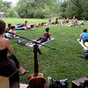 "Ariana Saraha, left,  provided the music for the yoga class.<br /> ""Yoga Rocks the Park"" began in Boulder's Central Park on Sunday. The yoga and music gathering will continue every Sunday through September 19, 2010.<br /> For more photos and a video of yoga in the park, go to  <a href=""http://www.dailycamera.com"">http://www.dailycamera.com</a>.<br /> Cliff Grassmick / August 8, 2010"
