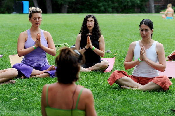 "Olivia Katz, left, Stephanie Pollock and Margo Rosingana, follow the instruction of teacher, Jeanie Manchester, left, during their yoga class.<br /> ""Yoga Rocks the Park"" began in Boulder's Central Park on Sunday. The yoga and music gathering will continue every Sunday through September 19, 2010.<br /> For more photos and a video of yoga in the park, go to  <a href=""http://www.dailycamera.com"">http://www.dailycamera.com</a>.<br /> Cliff Grassmick / August 8, 2010"
