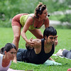 "Teacher Jeanie Manchester helps Roberto Pesce with his form.<br /> ""Yoga Rocks the Park"" began in Boulder's Central Park on Sunday. The yoga and music gathering will continue every Sunday through September 19, 2010.<br /> For more photos and a video of yoga in the park, go to  <a href=""http://www.dailycamera.com"">http://www.dailycamera.com</a>.<br /> Cliff Grassmick / August 8, 2010"