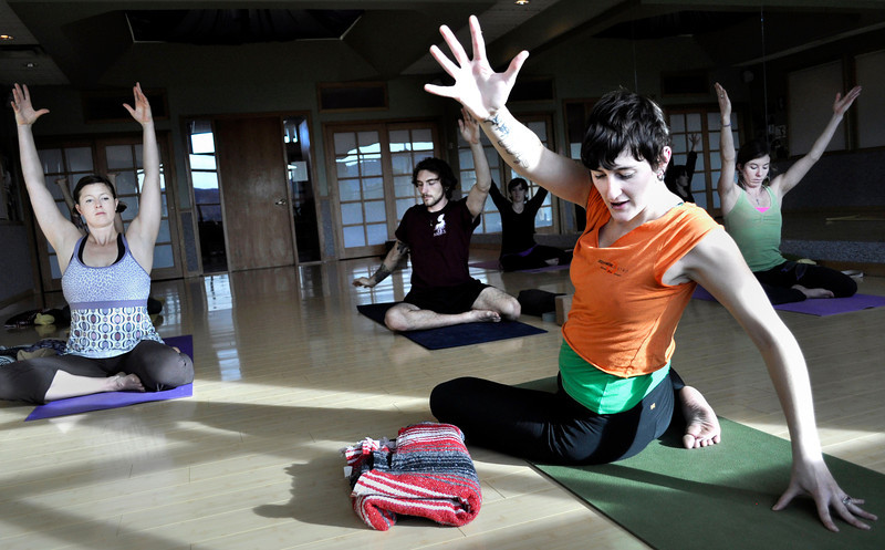 "Melissa Carey, front, leads her Yoga for Wellness class at Bodywork Bistro in Boulder on Monday Dec. 10, 2012. DAILY CAMERA/ JESSICA CUNEO. <br /> For video and a photo gallery go to  <a href=""http://www.dailycamera.com"">http://www.dailycamera.com</a>"