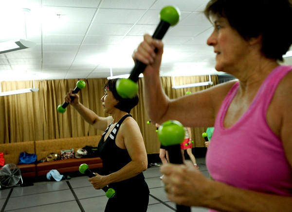 "From left, San Adams, of Boulder and Mary Zabel, of Boulder work out with toning sticks at Zumba Gold Tuesday morning. Zumba Gold is a low impact version of Zumba but still maintains the basics of Zumba. July 3, 2012. Rachel Woolf/ For the Daily Camera. For more photos and a video of the workout, go to  <a href=""http://www.dailycamera.com"">http://www.dailycamera.com</a>."