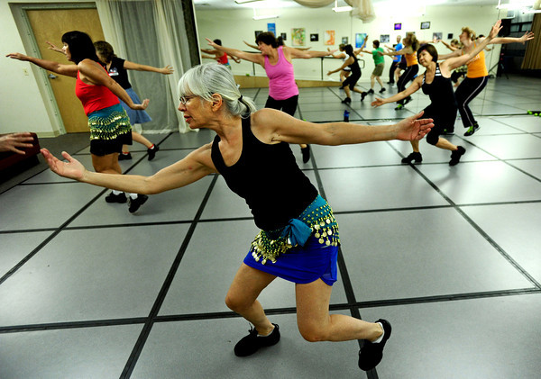 "Center, Barbara Weiss, of Boulder, works out during Zumba Gold Tuesday morning. Zumba Gold is a low impact version of Zumba but still maintains the basics of Zumba. July 3, 2012. Rachel Woolf/ For the Daily Camera. For more photos and a video of the workout, go to  <a href=""http://www.dailycamera.com"">http://www.dailycamera.com</a>."