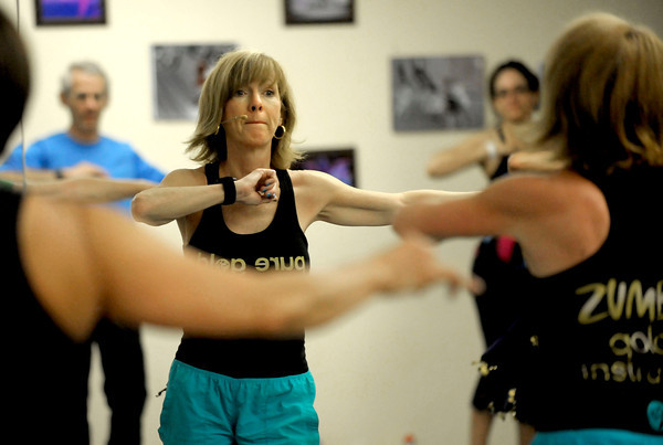 "Instructor Mary Kay Gibson, of Broomfield leads the class during Zumba Gold Tuesday morning. Zumba Gold is a low impact version of Zumba but still maintains the basics of Zumba. July 3, 2012. Rachel Woolf/ For the Daily Camera. For more photos and a video of the workout, go to  <a href=""http://www.dailycamera.com"">http://www.dailycamera.com</a>."