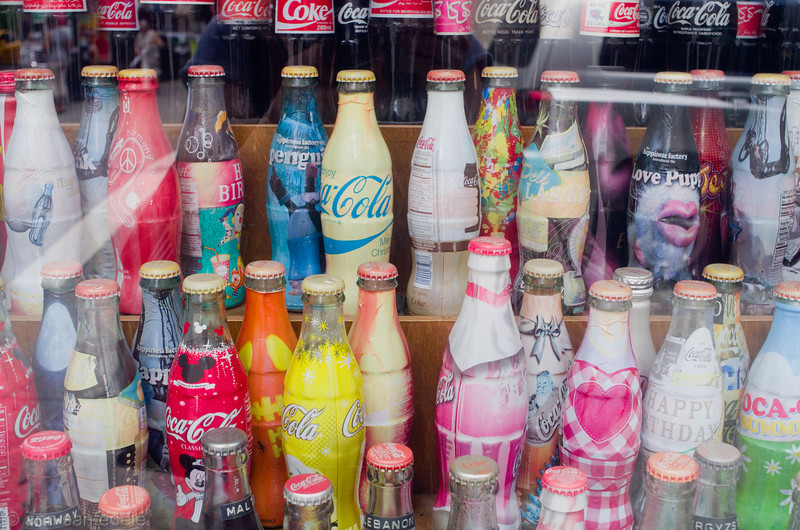 Cola Bottles in window of Soda Fountain / candy store on Lexington avenue