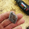 Some grinding work got me the rough diamond shape. Working with this rock was surprisingly difficult, I found that most of my dremel tools wouldn't really touch it for hardness, which I gradually learned is the case for a lot of rocks in general. I don't know the hardness rating of this particular one, but it seemed pretty hard to me!