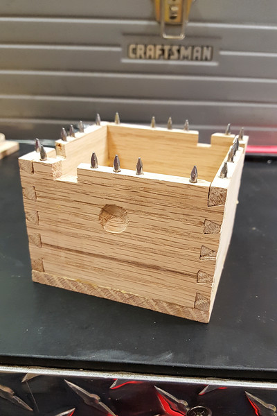 The body of the box assembled after installed the spikes, and without the dice slots installed. This box will eventually nest inside a larger box, so I drilled some finger slots in the side for pulling this one out.