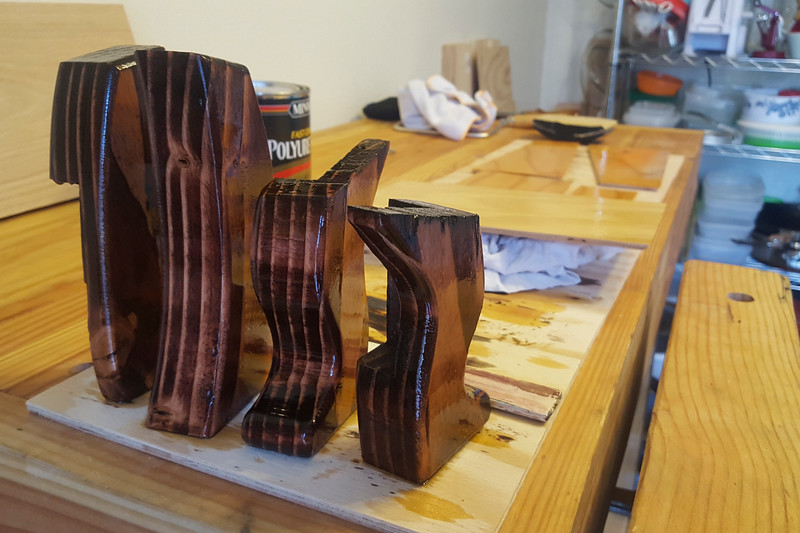 With all the pieces cut, the next step was a coat of stain for the legs and some polyurethane top coat for everything.