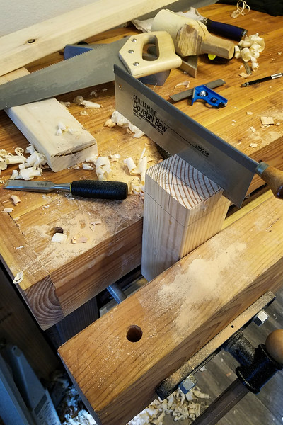 Coming up with a decent simple dovetail pattern took me a few minutes, and then I drew it out on the end of the 2x4s and cut those first.