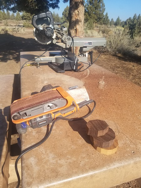 With a few leftovers of exotic woods lying around, I figured it was time to crank out a couple phone holders. I started by cutting rough outlines on the chop saw and then used the belt sander to smooth those out into pleasing shapes.