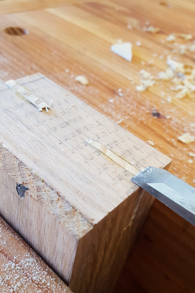 Once the glue dried, the reinforcing bars were trimmed flush with a saw and chisel.