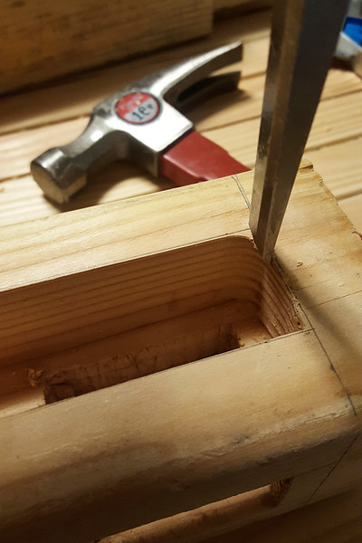 Going back to the mortises for my sliding bars, I finished up the corners with a chisel, trying to make them as neat as I could. It's not quite as smooth as the routered parts, but it'll do!