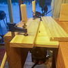 I've proven to be not very good at using a router in the proper orientation, so I adapted one of my scraps and turned it into a router table, which has so far proven very handy. Shown here just after making a dado for one of my drawer bottoms.