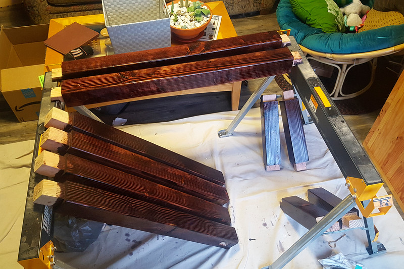 With the frame members all finished and sanded, I gave them a couple coats of stain and polyurethane to dress them up nice.