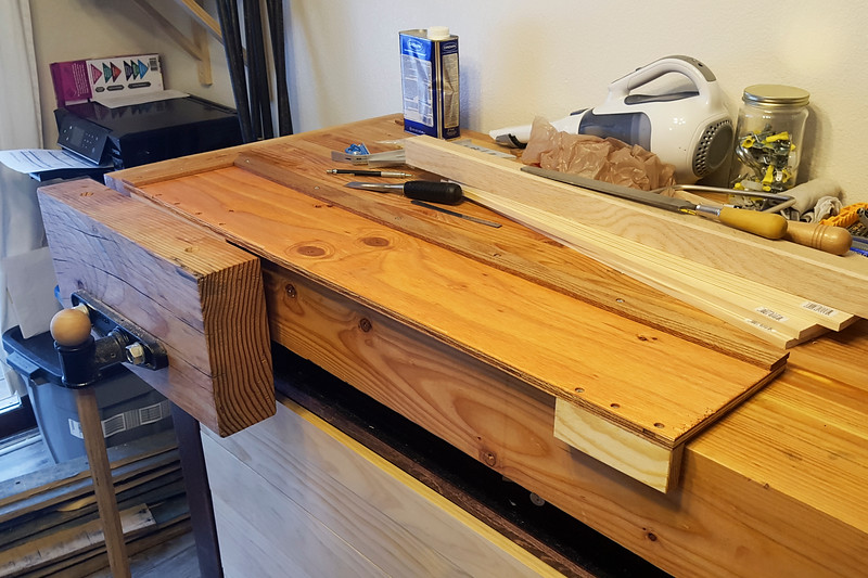 The finished bench stop for skinnier stock, shown clamped in the vise and ready to go, with a coat of boiled linseed oil for the finish.