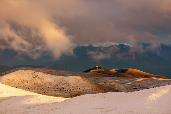 Rolling hills on Campo Imperatore with the old castle