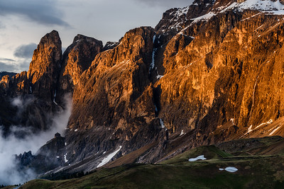 Last light on the mountain wall with a waterfall
