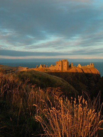 large depth of field from warm grass in foreground to castle in background of landscape photo