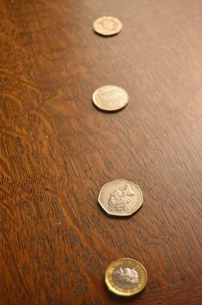 shallow depth of field in photo of line of coins taken at f5.6