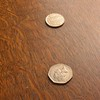 large depth of field in photo of cline of coins taken at f32