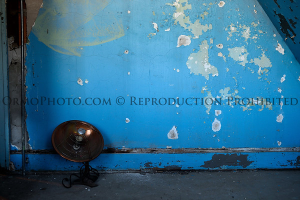 Heat Lamp and Blue Wall