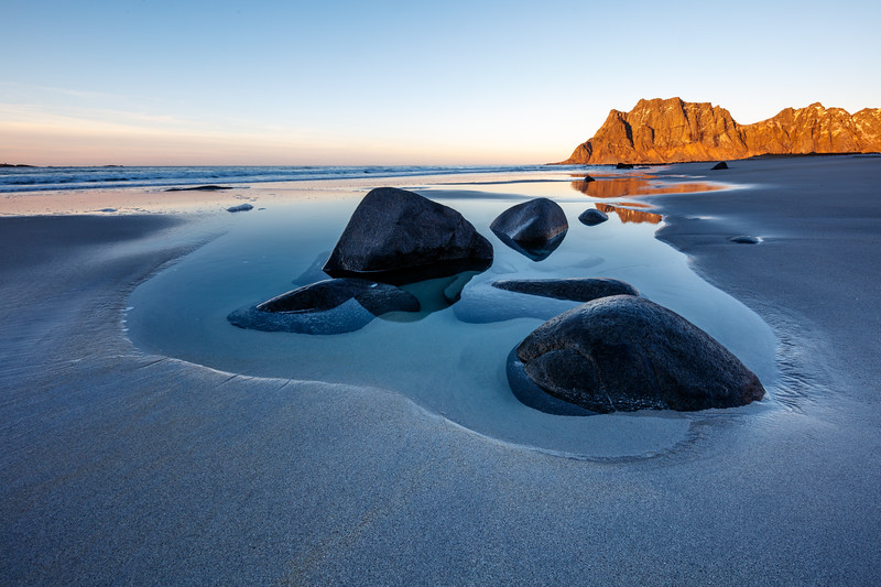 Pools on the beach at sunset