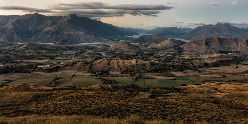 The view after sunrise from Coronet Peak above Queenstown and Lake Wakapitu.