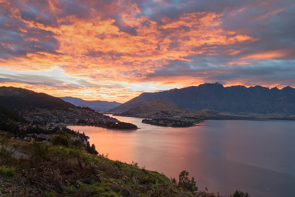 Sunrise shoot on a bluff overlooking Lake Wakatipu and the Remarkables.