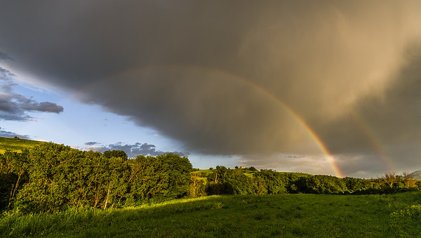 Double rainbow over Tuscan fields