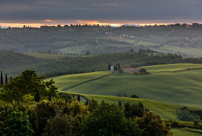 Morning in Val d'Orcia with the chapel in the fields.