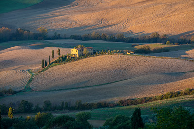 Tuscan farmland at sunrise