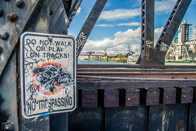 Using the sign as a foreground element. Processed this to a gritty look because it was a gritty scene.