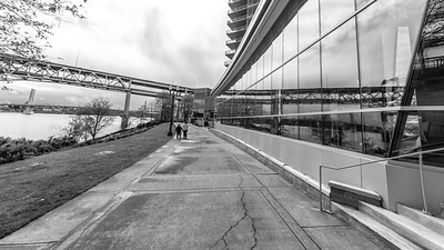 Marquam bridge reflecting with the appearance of it going into the building. Thanks for the idea Craig!. Shot at 12mm but should have moved forward to eliminate the railing and steps. and even the tree branches. Will try this one again.