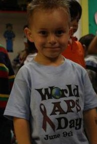 Tyler, son of Tarra Strauss Dodaj, shows his support of World APS Day in memory of is uncle, Jason Corie Strauss (1972-2009).