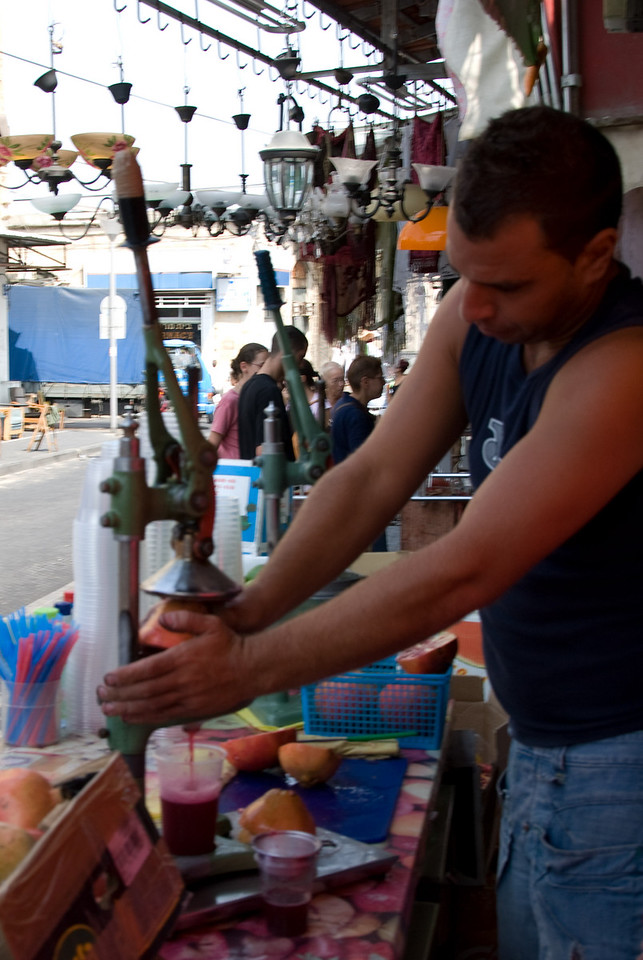This vendor was selling fresh squeezed pomogranet juice