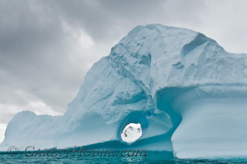 Hole in an iceberg near Cuverville Island.