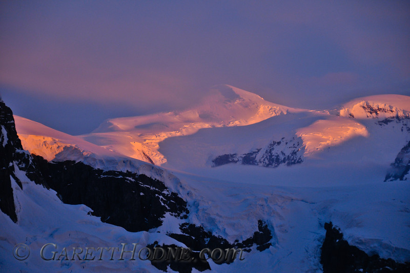 Alpenglow on the peaks of  the Antarctic Peninsula.