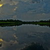 Reflection of storm clouds on the varieza lake.