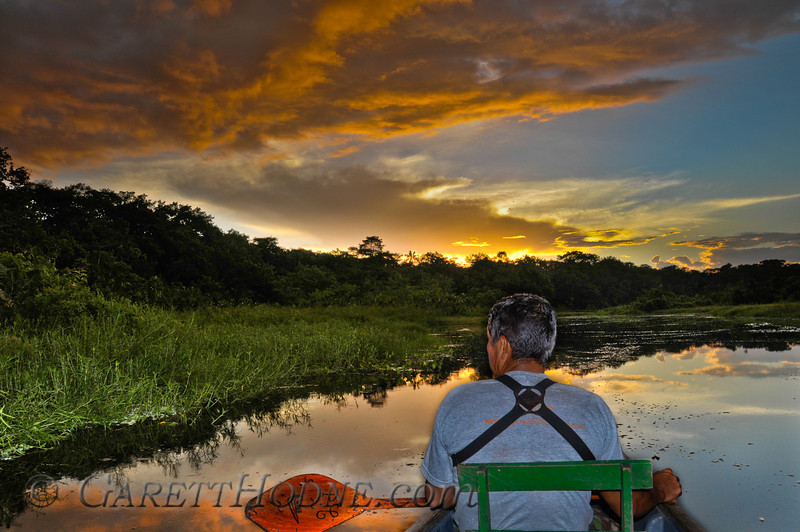 Birding from the canoe with an approaching storm on the variaza lake.
