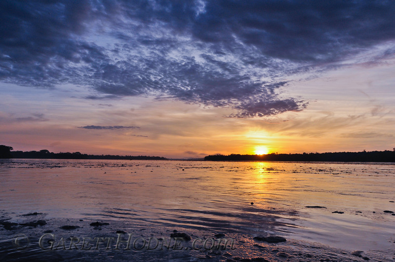 Amazon sunrise over the Napo River at flood stage.
