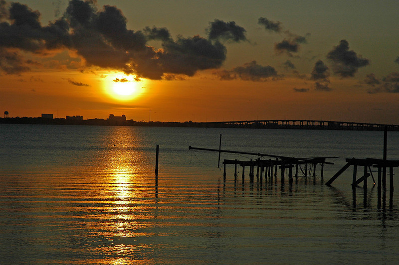Sunset while sitting on a comfy bench in Rykman Park, Melbourne Beach, Florida.