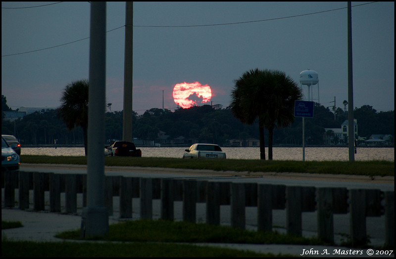 Big red sunset from the Eau Gallie Causeway in Melbourne, Florida.